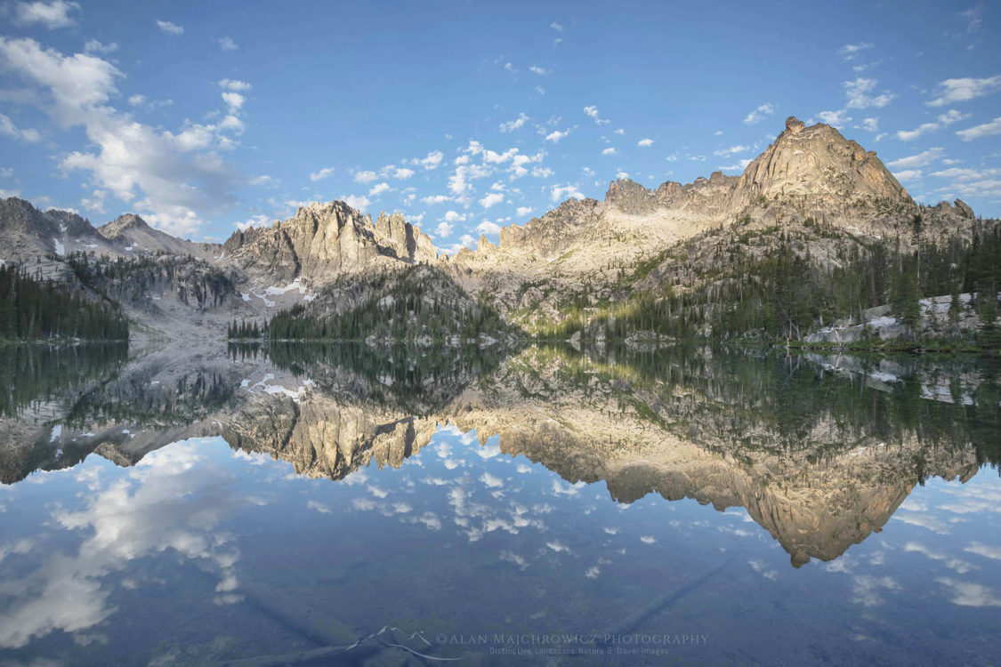 Monte Verita Peak mirrored in still waters of Baron Lake. Sawtooth Mountains Wilderness Idaho