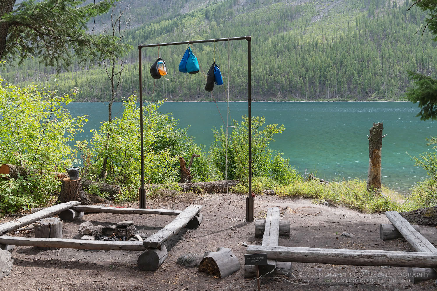 Food bags hanging for bear safety at food prep area of Kintla Lake Campsite Glacier National Park Montana
